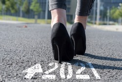 Woman in high heels is approaching the year 2021