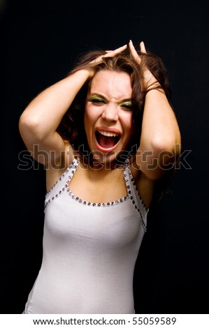 woman in hysterics on a black background.family problems.fury. - stock photo