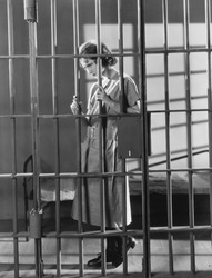Woman in jail cell