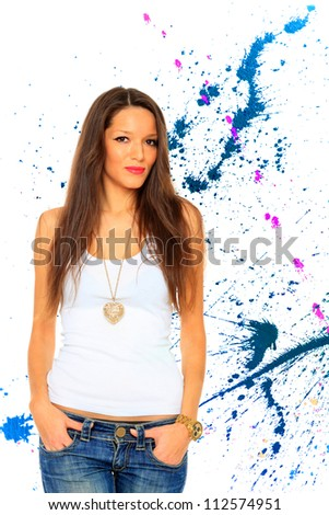 Woman in jeans over abstract background