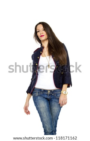 Woman in jeans posing over white background