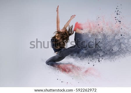 Woman in jump. Frozen motion. Photo manipulation of disintegration