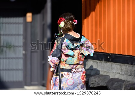 Woman in kimono playing with soap bubbles