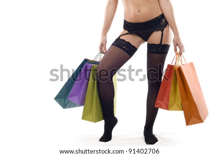woman in lingerie holding a bag of colors on a white background