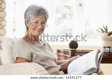 Living Room on Woman In Living Room Reading Book Smiling Stock Photo 14241277