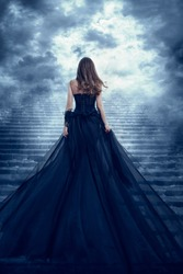 Woman in Long Dress Back Rear View Climbing Stone Stairs to Sky, Girl Raising Mystic Dark Night Way