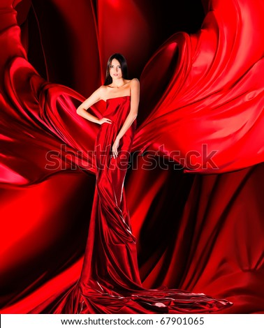 woman in long red dress on red fabric