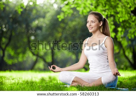 Woman in lotus pose in the park