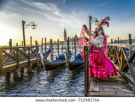 woman in masks and costumes on Venetian carnival