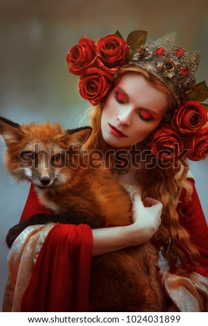 Woman in medieval clothes with a fox