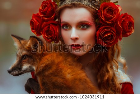 Stock Photo Woman in medieval clothes with a fox
