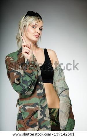woman in military clothes with sunglasses army girl on gray background ...