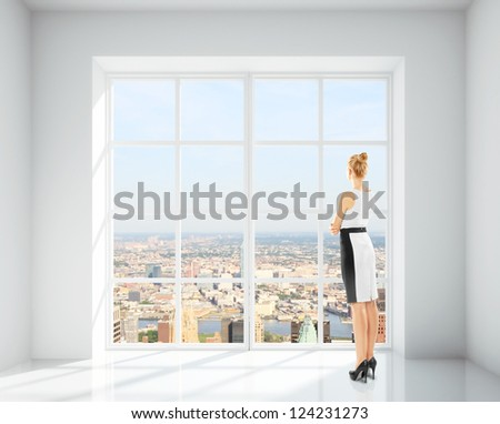 woman in office and city views