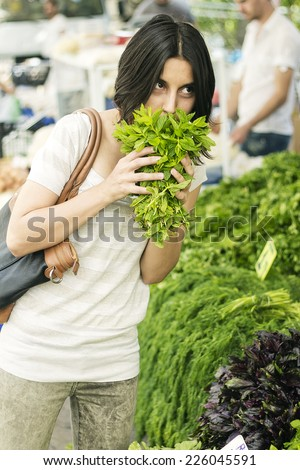 Woman in Open Market Smell Fresh Herbs / Open Air Market with Fresh Vegetables and Herbals