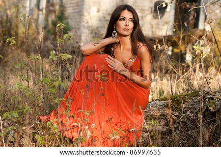 woman in orange dress at the nature
