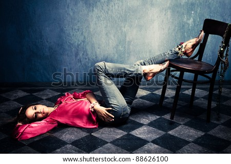woman in oriental shirt and shoes lie on floor