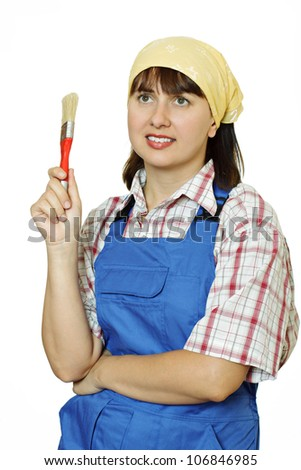 Woman in overalls and paint brush in her hand. White background.
