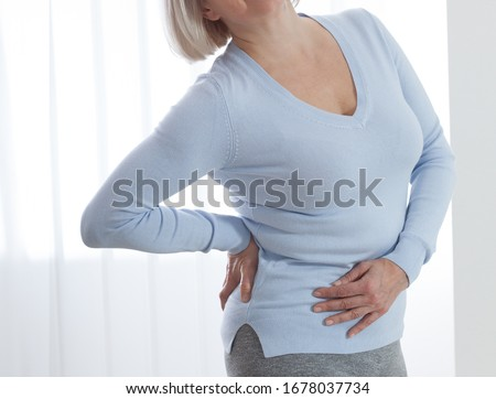 Woman in pain holding her stomach on the right side. Concept photo with indicating location of the pain. Health care concept Foto d'archivio ©