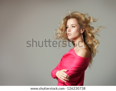 Woman in Pink Blouse on Gray Background