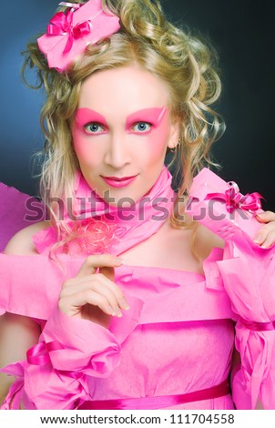 Woman in pink. Portrait of young creative lady with present box.