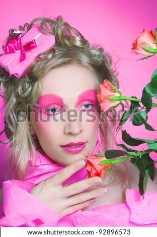 Woman in pink. Portrait of young lady with roses.