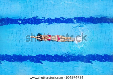 woman in pool - top view