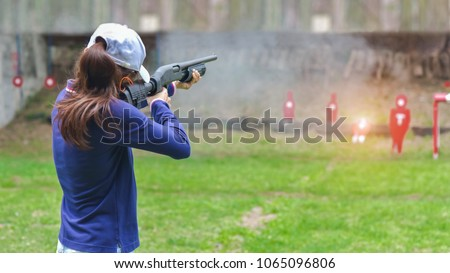 woman in practice shooting gun riffle in martial arts for self defense in an emergency case