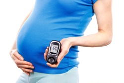 Woman in pregnant holding glucose meter with result of measurement sugar level, concept of diabetes during pregnancy, expecting for newborn