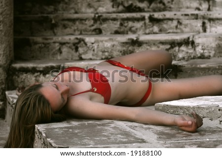 woman in red bikini dead on the stairs