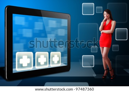Woman in red dress and First Aid icon on tablet pc