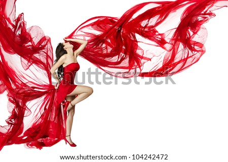 Woman in red dress flying on a wind flow dancing over white background