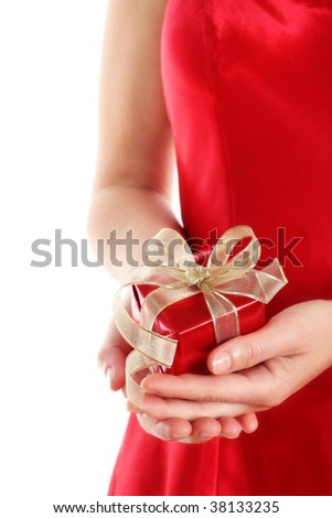 Woman in red dress holding a small red gift box with gold ribbon on white background