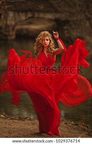 Woman in Red Dress, Lady Fantasy Gown Flying and Waving #1029376714