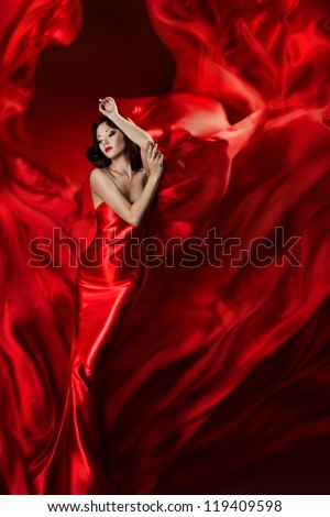 Woman in red dress posing with waving fabric, Girl fantasy dreams concept