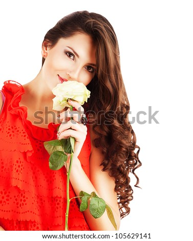 woman in red dress with long curly hair and white rose in hands on white background