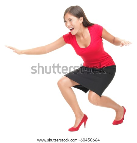 Woman in red having fun surfing / doing surf move. Casual funny young Asian / Caucasian businesswoman isolated on white background.