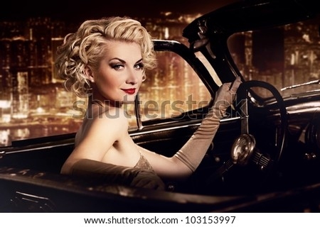 woman in retro car against...