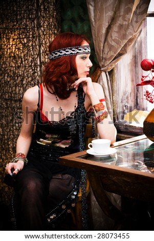woman in retro clothes sitting in cafe - stock photo