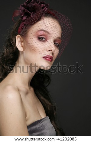 woman  in retro-styled bordeaux veil with make-up