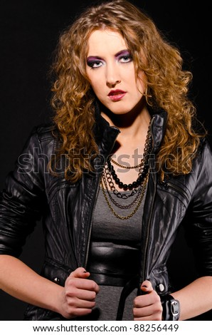 woman in rock and roll style on black background
