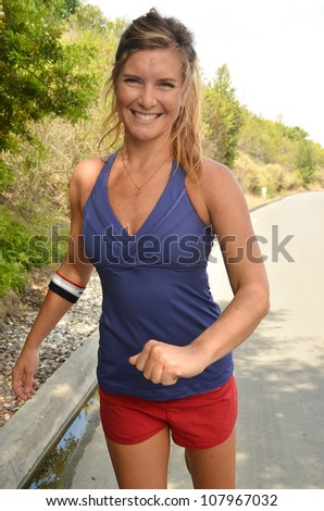 Woman in running outfit/Woman Jogger/Attractive young woman preparing for her morning run