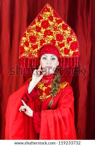 Woman in russian traditional clothes posing