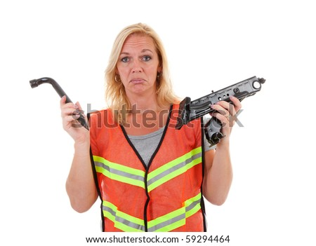 Woman in safety vest holding car breakdown jack and is not knowing what to do with is, over white background