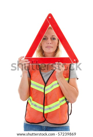 Woman in safety vest holding foldaway reflective road hazard warning triangle over white background