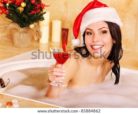 Woman in santa hat relax in bath. Christmas concept.
