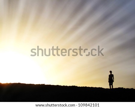 Woman in Setting Sun Rays