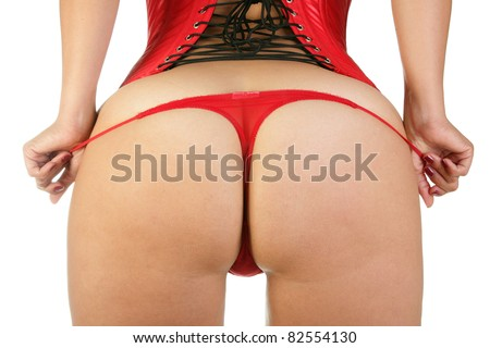 Woman in sexy red corset and red thongs