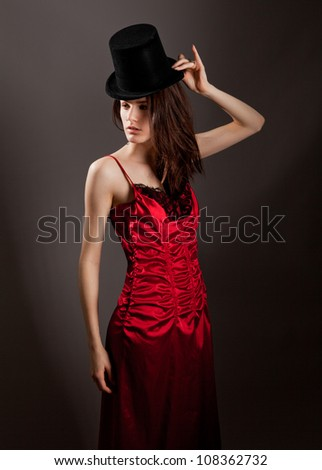Woman in Shiny Red Dress and Top Hat