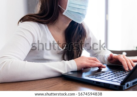 Woman in smart working in front of a laptop typing text during online conference. Smart working activities during quarantine coronavirus covid-2019 pandemic disease in italy. Working at home