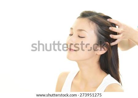 Woman in spa salon receives head massage - Shutterstock ID 273951275
